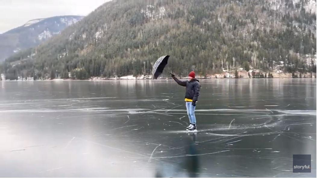Man Travels Mary Poppins Style Across Frozen Lake With Umbrella