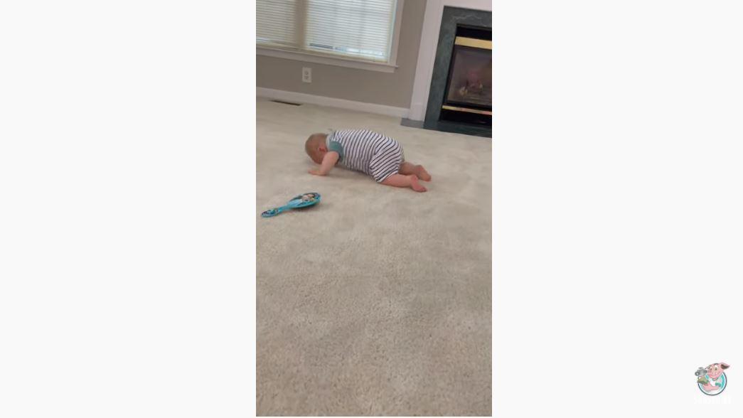 Baby Crawls Face First Across Floor