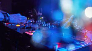 Closeup of a DJ keypad with vinyl records