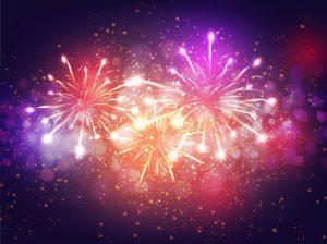 Colorful Fireworks Lighting Effect on Purple Background for Celebration Concept.