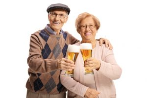 Senior couple holding pints of beer