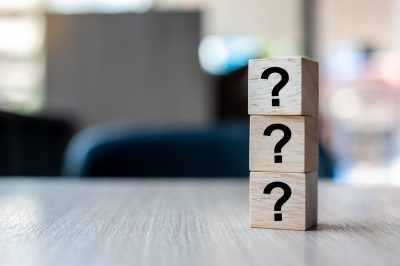 Questions Mark ( ? ) word with wooden cube block on table background. FAQ( frequency asked questions), Answer, Q&A, Information, Communication and Brainstorming Concepts