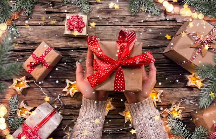 Top view of woman hands with gift box