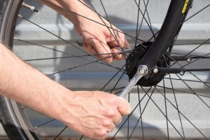 A close up of a bicycle wheel being fixed