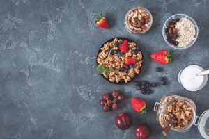 Healthy breakfast with muesli, fruits, berries. Flat lay, top view