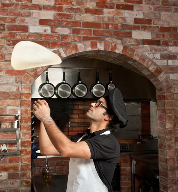 MUNDANE MYSTERIES: Why do pizza chef's toss the dough in the air?