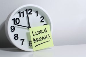 Lunch break note on office clock