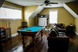 Yellow gold upstairs bonus room with pool table