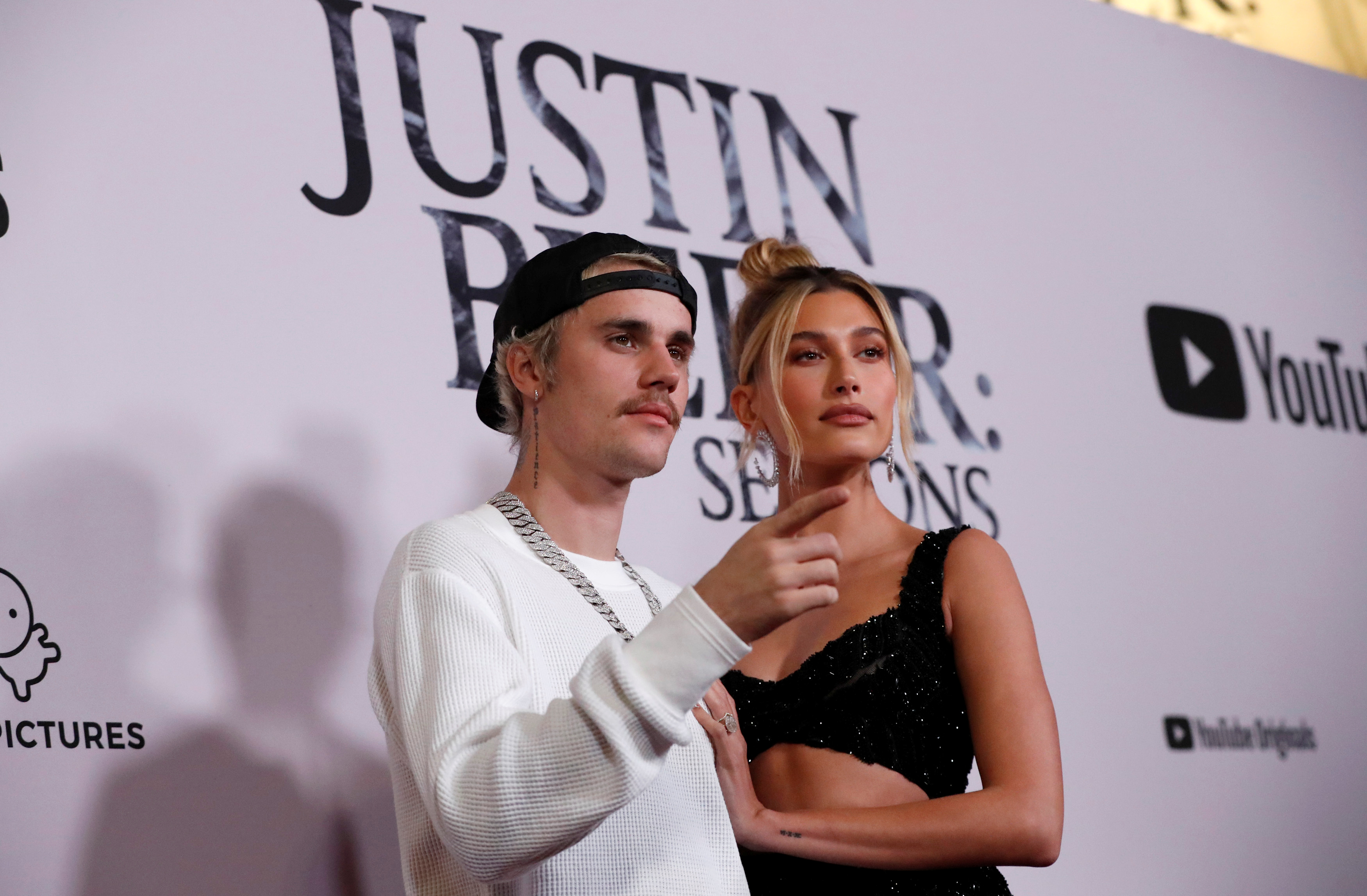 """Singer Bieber and his wife Hailey Baldwin pose at the premiere for the documentary television series """"Justin Bieber: Seasons"""" in Los Angeles"""