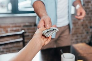 cropped shot of dad giving pocket money to daughter