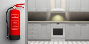 Fire extinguisher on wall, blur house kitchen background. 3d illustration