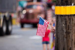 Girl Waving American Flag at Parade
