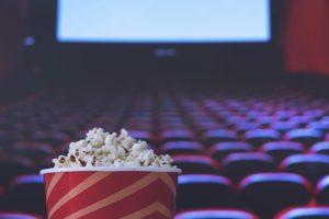 pop corn and on red armchair cinema