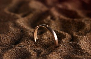 golden ring close-up on the beach sand