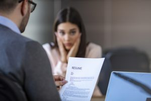 Nervous young job applicant wait for recruiters question