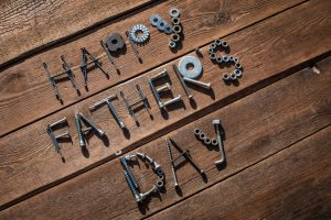 Happy Father's Day. Greeting made of nuts and bolts