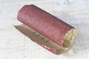 Emery paper - sandpaper on white wooden board