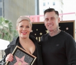 Pink and husband Carey Hart auction off motorcycle gas tanks for charity