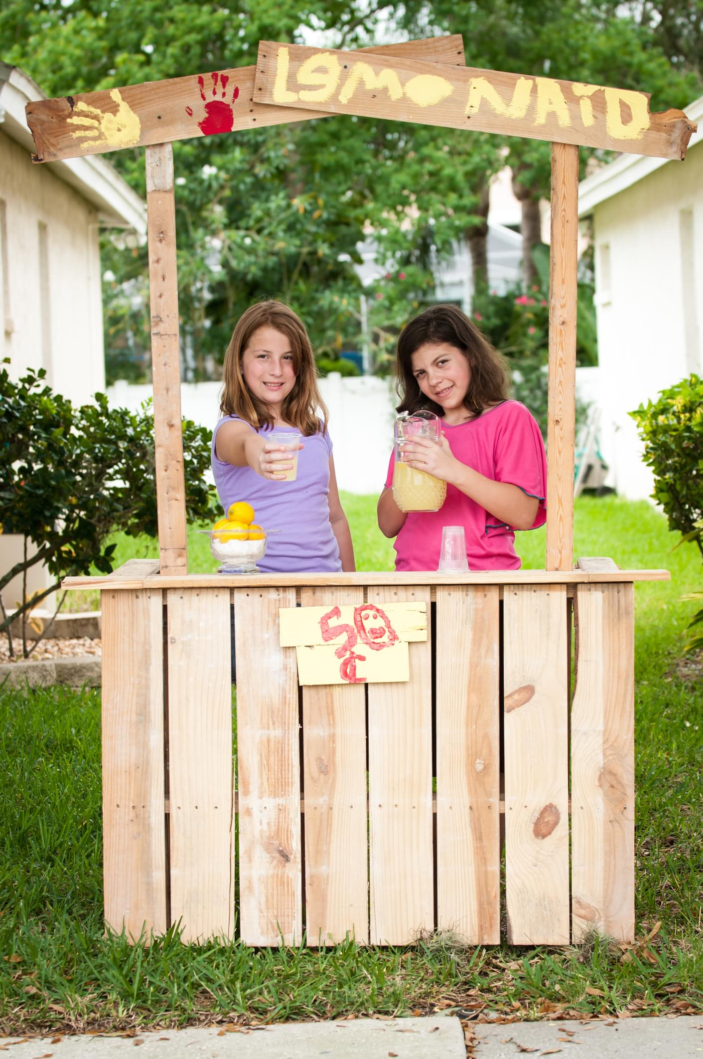 Young girls selling lemonade