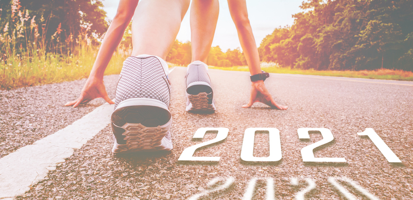 Start 2021 symbolises the start into new year. The start of people running on street is healthy new normal, with sunset light. Goal of Success