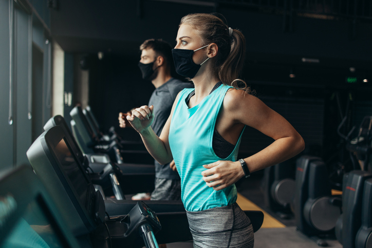 Sporty people exercising in fitness gym