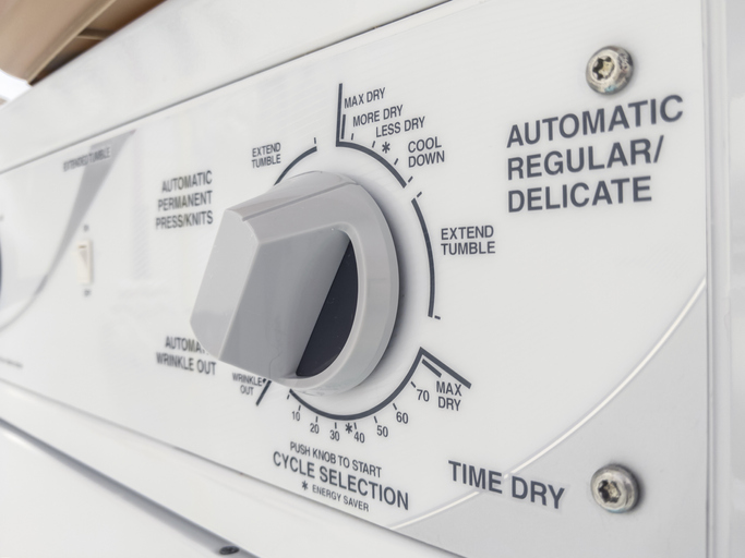 knob on a clothing dryer control panel