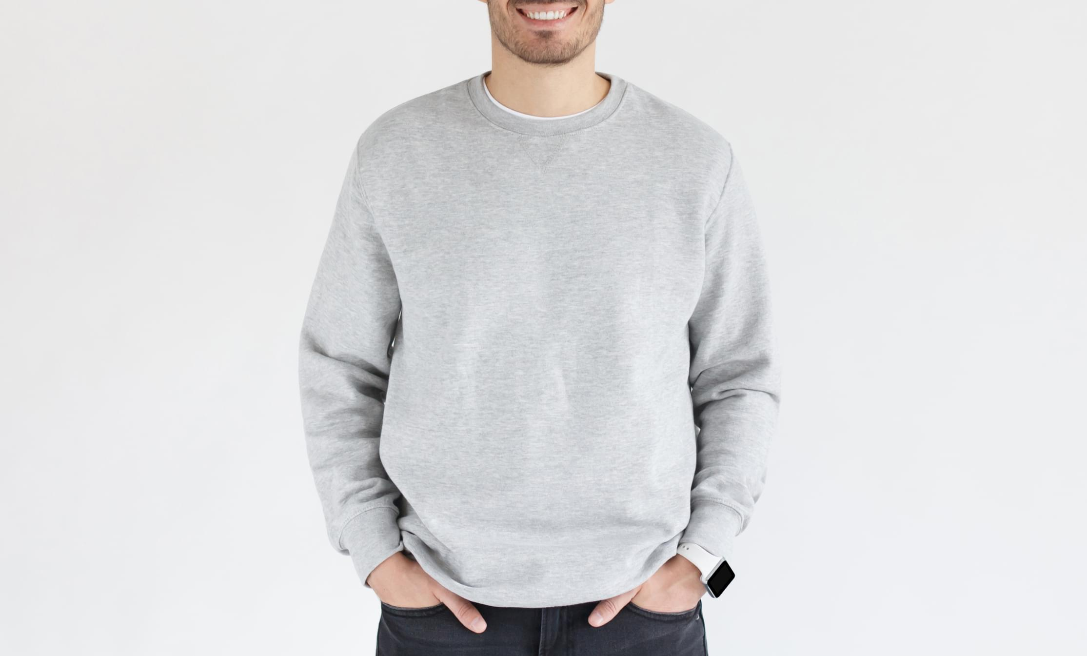 Mock up of young man in gray sweatshirt, standing isolated on background. No face photo