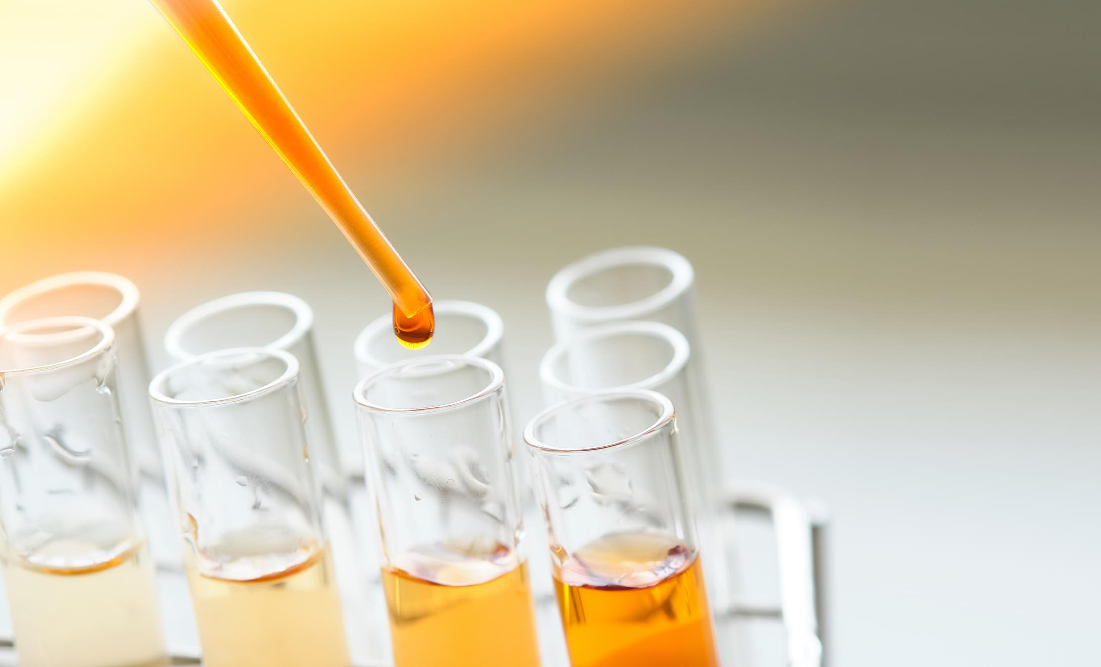 equipment and glassware for test product extraction and orange color solution, in the chemistry laboratory.