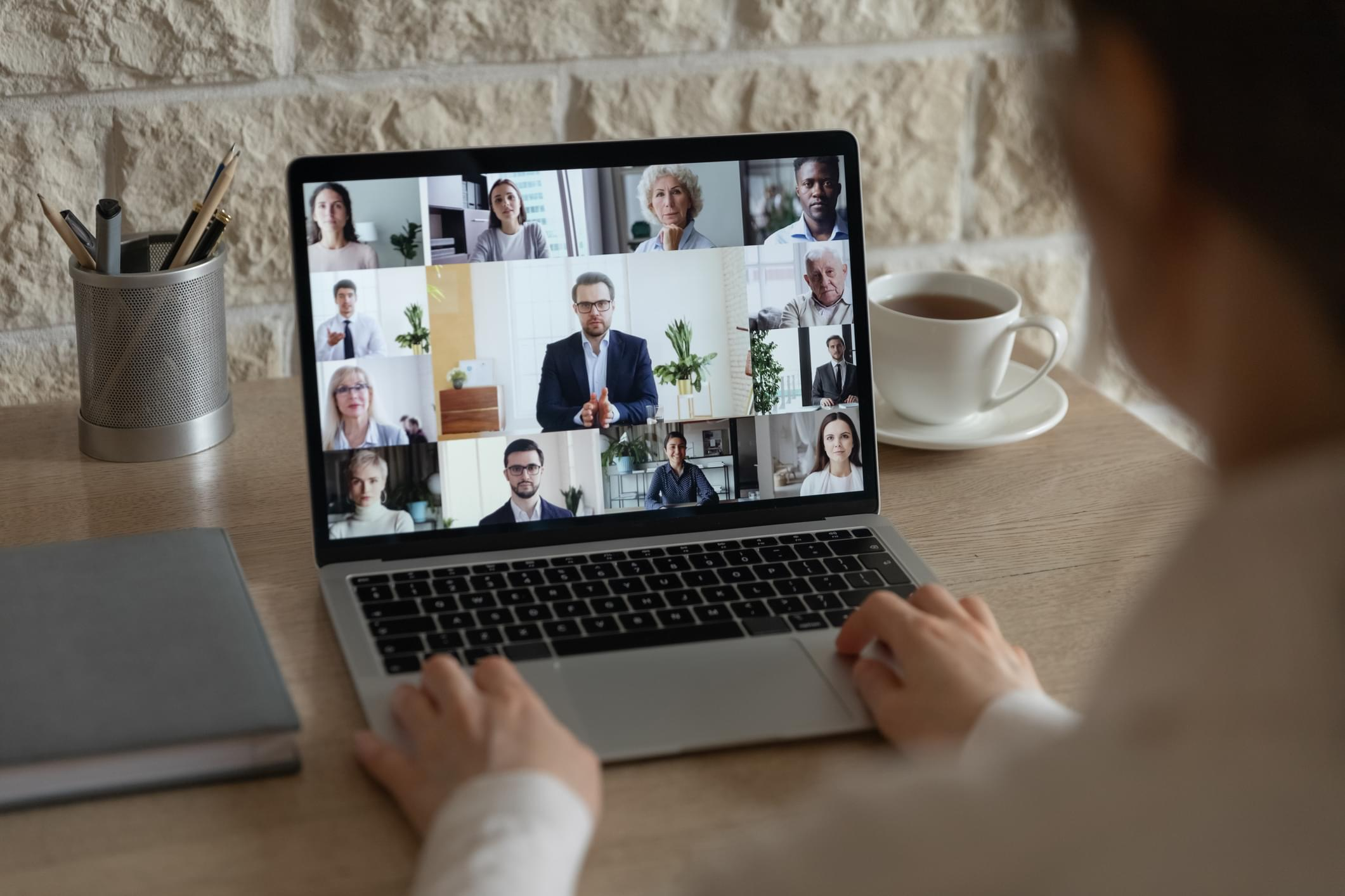 Diverse colleagues talk on video call having online briefing