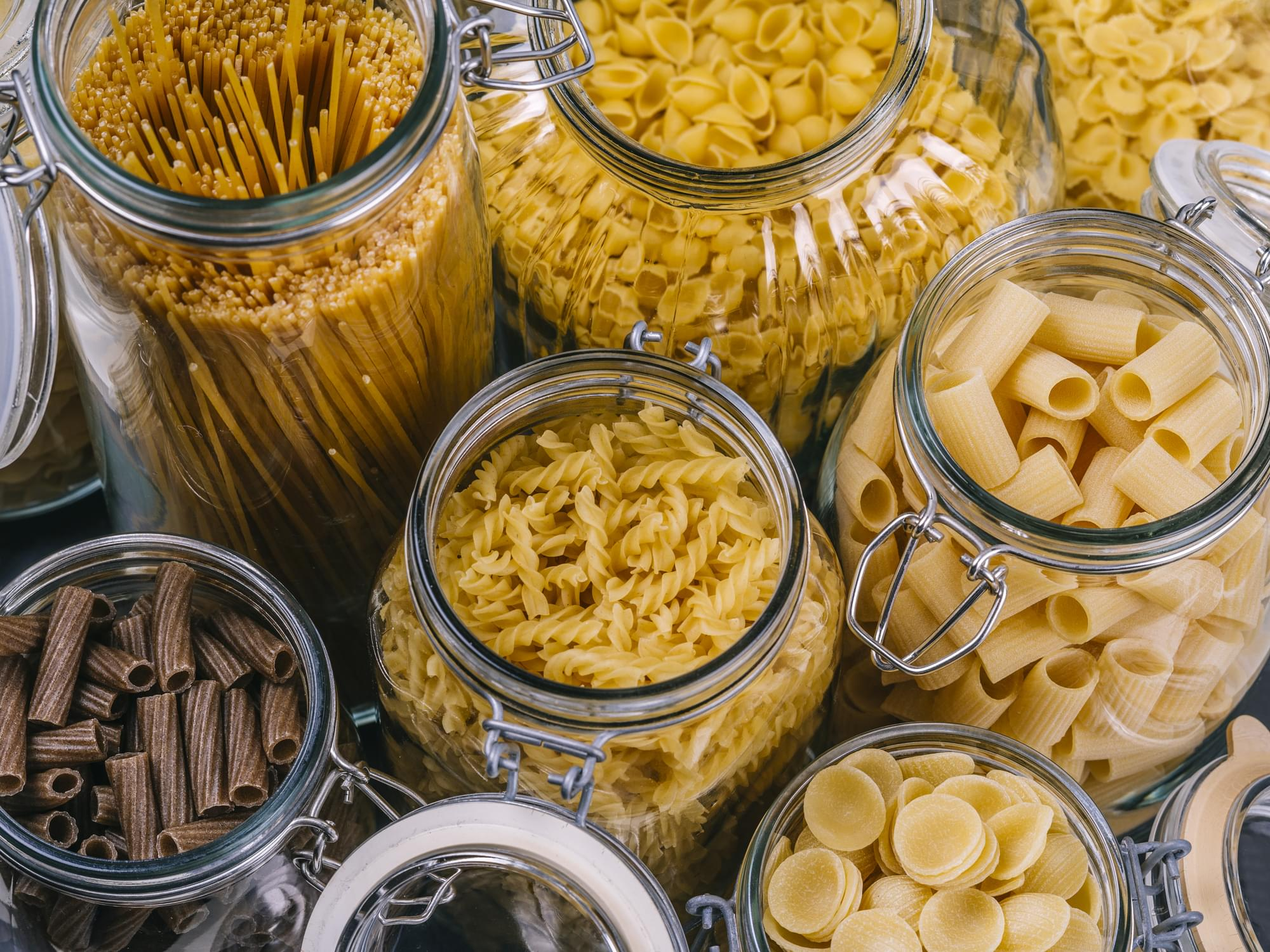 Different pasta in large glass jars