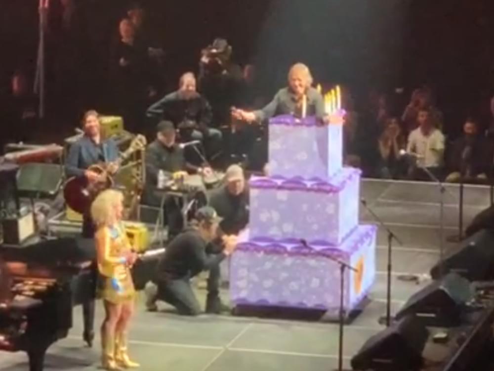 Watch Keith Urban Jump Out of a Cake to Fulfill Loretta Lynn's Birthday Wish