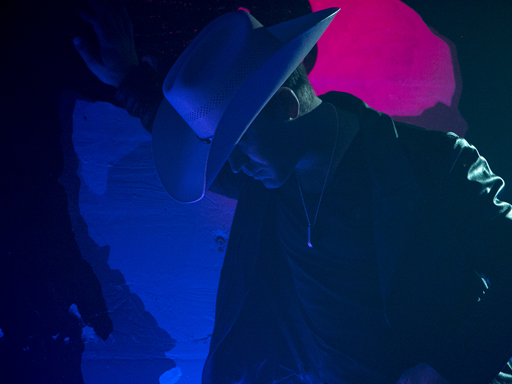 """Watch Justin Moore's Colorful New Video for """"Somebody Else Will"""""""