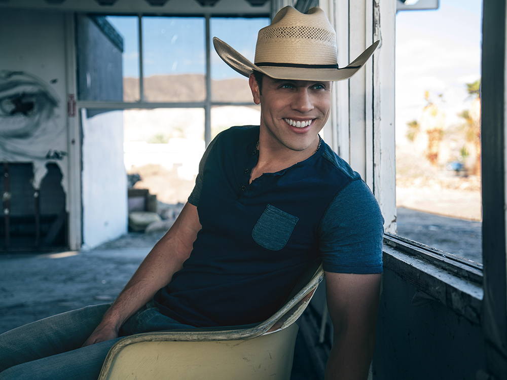 "Watch Dustin Lynch's Sparkling New Lyric Video for ""Small Town Boy"""