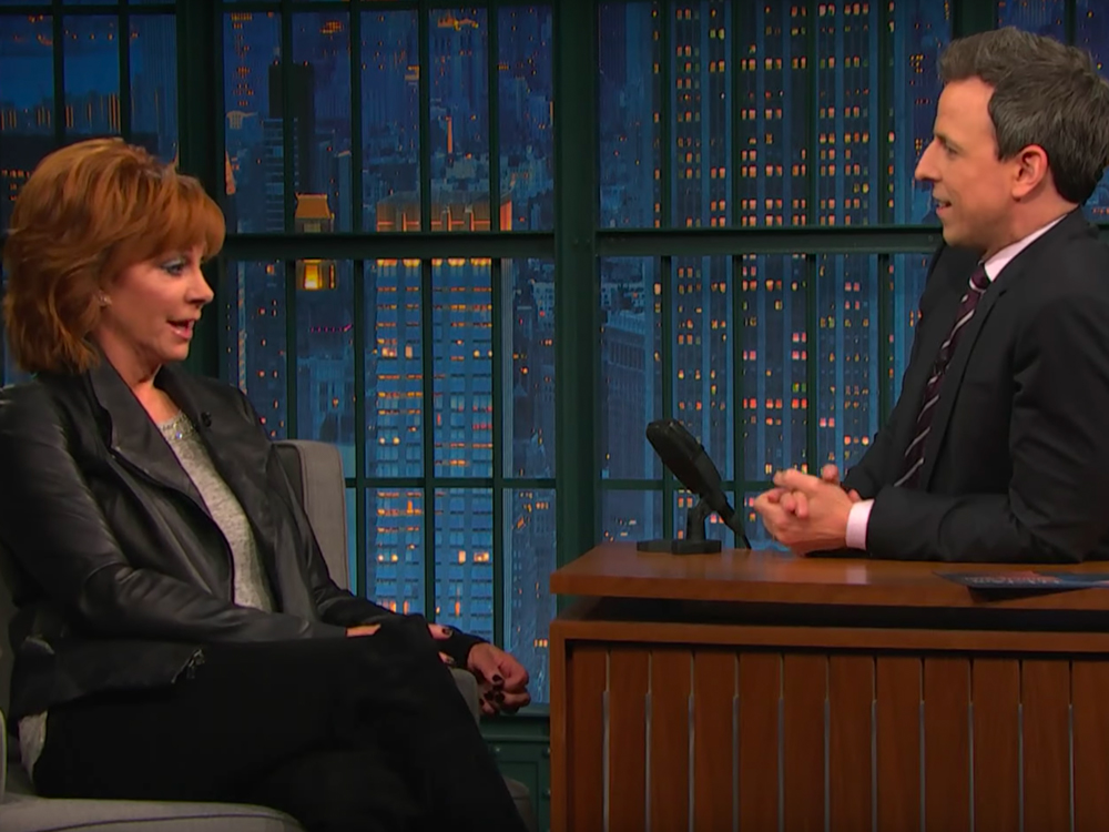 """""""Late Night With Seth Meyers"""" Reveals Reba McEntire Was Born With a Proper English Accent [Watch]"""
