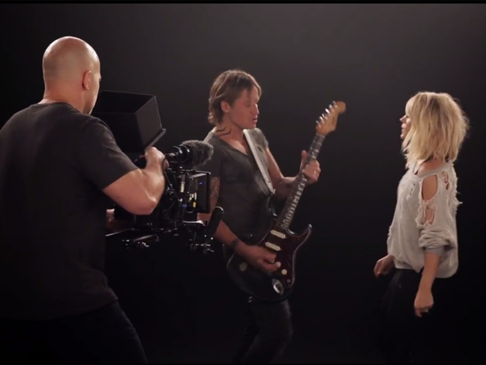 "Keith Urban Takes You Behind-the-Scenes of ""The Fighter"" With Carrie Underwood"