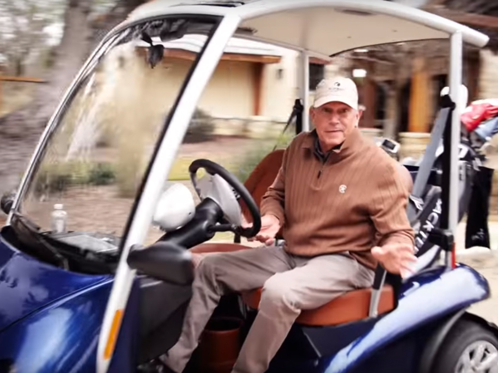 Watch George Strait Ride Away in a New Golf Cart Commercial