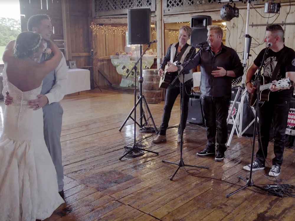 "Watch Rascal Flatts Surprise Wedding Couple With First Dance Performance of ""God Bless the Broken Road"""
