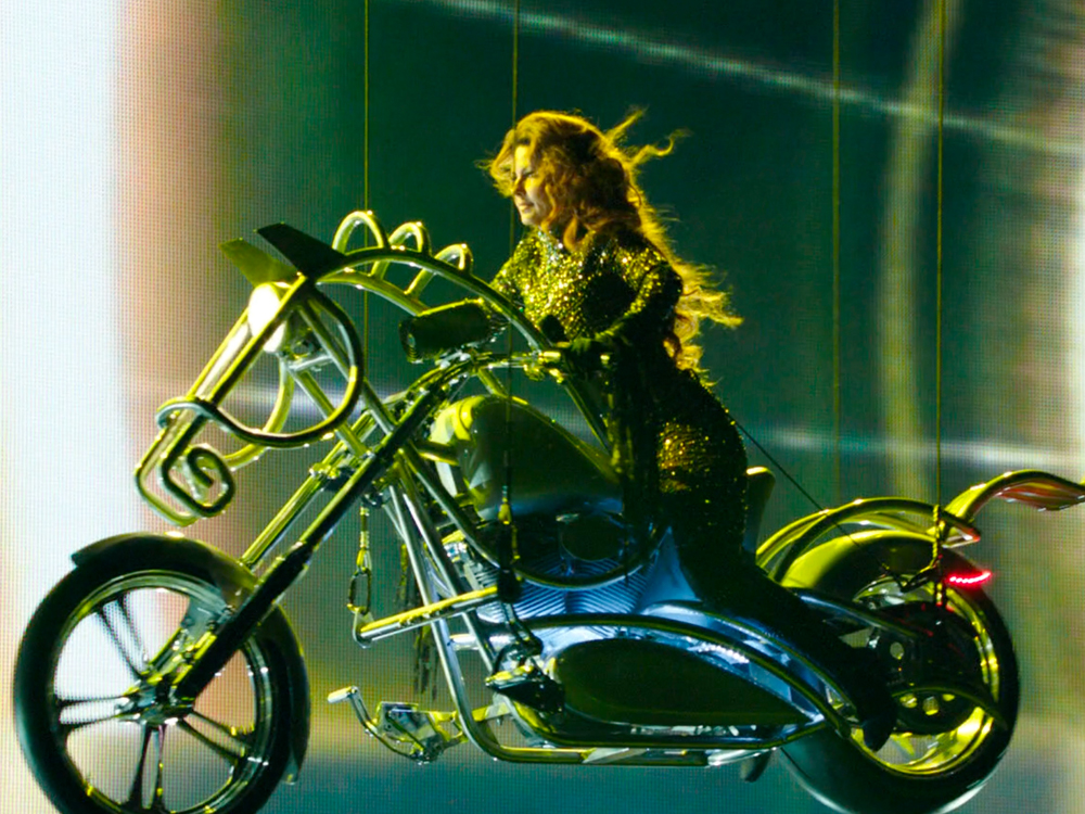 "Charity Fundraiser: $40 Will Get You Shania Twain's New Album, $100,000 Will Get You Her ""Flying Horse"" Motorcycle From Vegas Showcase"