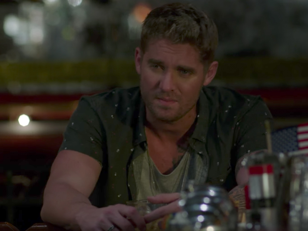 "Watch Brett Young Drown His Sorrows in New ""Like I Loved You"" Video"