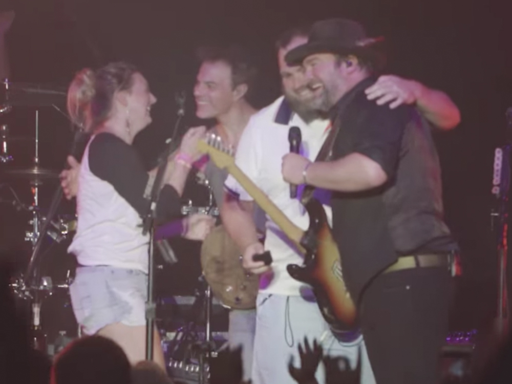 Watch Lee Brice's Friend Crash His Concert to Propose to Girlfriend