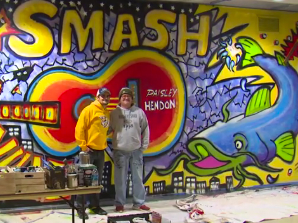 Brad Paisley Teams With Local Artist to Paint Mural Inside Nashville's Bridgestone Arena