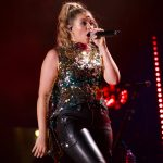 """Watch Lauren Alaina Perform Her No. 1 Song, """"Road Less Traveled,"""" Backed by All-Female Drumline & National Symphony Orchestra"""