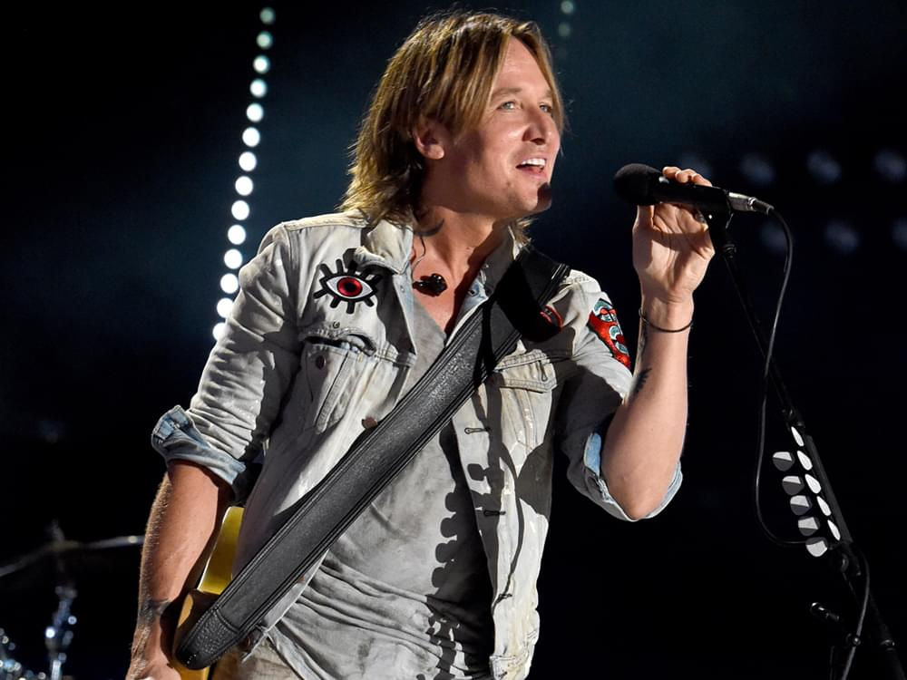 "Listen to Keith Urban's Feel-Good New Single, ""Never Comin' Down"""