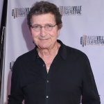 County Stars Remember Mac Davis, Including Reba McEntire, Kenny Chesney, Travis Tritt & More