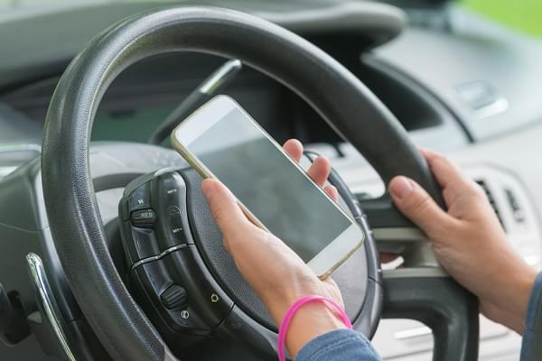 Using phone while driving the car