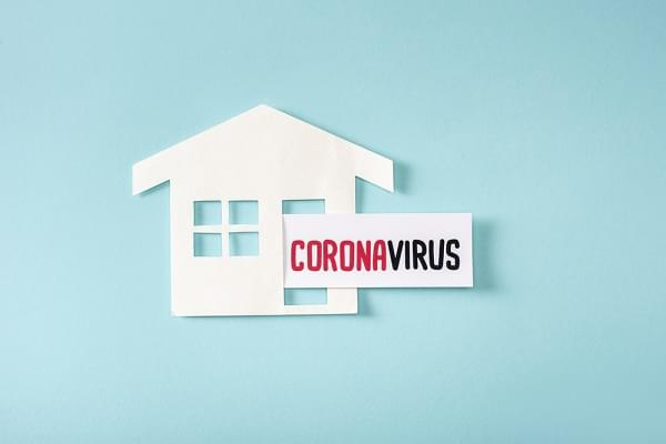 house with a paper that reads coronavirus