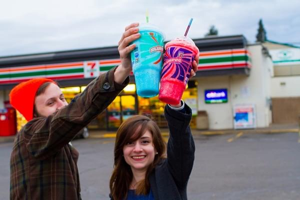 engaged couple with slurpees at a 7 Eleven