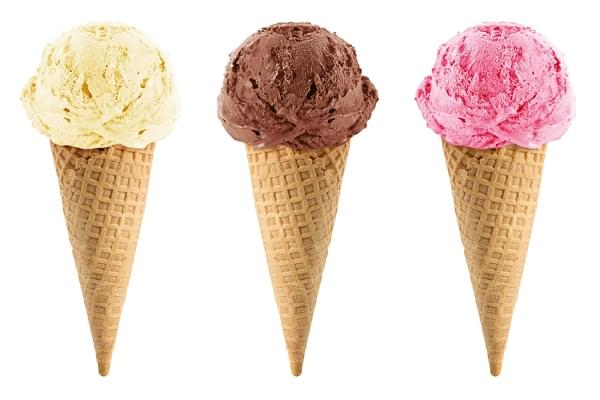 Chocolate, vanilla and strawberry Ice cream in the cone on white background with clipping path.