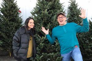 dave smiley and sarah with a christmas tree