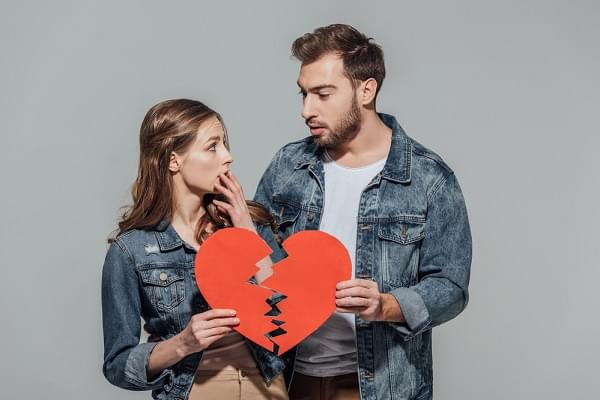 couple holding a broken heart
